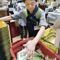 Collateral damage: A lowering of the eligibility cap for the kōsei nenkin pension plan leaves housewives working part-time with a choice: cut their hours to stay below the new ¥1.06 million-a-year ceiling or work more to offset payments they will now have to make into the pension system. | KYODO