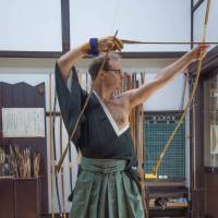 Jerome Chouchan musters his concentration before firing an arrow at the Urakami Dojo in Denenchofu, Tokyo. Chouchan wrote the Japanese book 'Target' about the lessons Japanese archery holds for business. | STEPHEN MANSFIELD