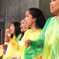 Going green: Women perform at last year's Gathering for Filipino Groups and Communities charity event at St. Anselm's Church in Tokyo. | CATHOLIC TOKYO INTERNATIONAL CENTER