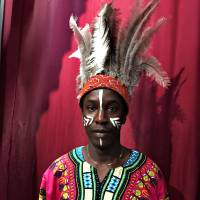 Out of Africa: Abdou Baye Fall, seen here decked out in Zulu style while working in Iwate this month. Baye Fall travels the country teaching children about the cultures of his homeland of Senegal.   COURTESY OF ABDOU BAYE FALL