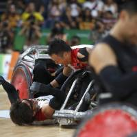 First for Japan: Daisuke Ikezaki (left) and Yukinobu Ike of Japan celebrate winning bronze medals in the playoff against Canada, which Japan edged 52-50, at the Rio Paralympics on Sept. 18. Japan won 24 medals at the games but no golds, a tally that won't be acceptable at the Tokyo Paralympics in 2020.   REUTERS