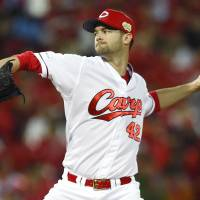 Carp left-hander Kris Johnson pitches in Game 1 on Saturday. | KYODO