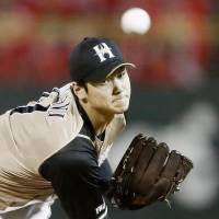 Fighters starter Shohei Otani struck out 11 batters in Game 1. | KYODO