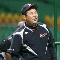 Chiba Lotte Marines manager Tsutomu Ito watches his team's practice at Yafuoku Dome on Friday. On Saturday, the Marines face the host Fukuoka SoftBank Hawks in Game 1 of the first stage of the Pacific League Climax Series. | KYODO