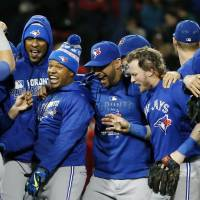 Blue Jays clinch top wild-card spot with win