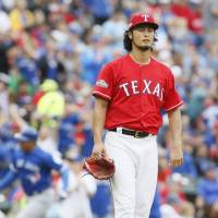 Jays up 2-0 after shelling Darvish
