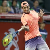 Kyrgios overcomes rough start against Goffin en route to Japan Open title