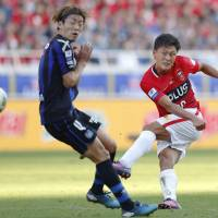 Tadanari Lee of the Urawa Reds, seen in action during Saturday's match, scored a tying goal in the 76th minute against Gamba Osaka. | KYODO