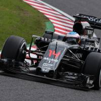 Fernando Alonso drives during practice for the Japanese Grand Prix on Friday in Suzuka, Mie Prefecture. | AFP-JIJI