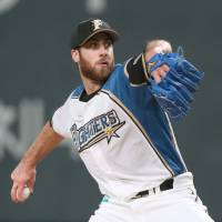 Fighters reliever Anthony Bass, who has previously pitched for the San Diego Padres, Houston Astros and Texas Rangers, has made a huge impact for his team this postseason. Bass has a 0.00 ERA in six appearances. | KYODO