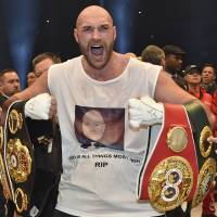 Fury gives up world titles to focus on rehab