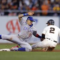 Cubs rally past Giants to reach NLCS