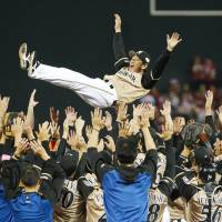 Hokkaido Nippon Ham Fighters manager Hideki Kuriyama receives the traditional doage (victory toss) after the team defeated the Hiroshima Carp 10-4 in Game 6 of the Japan Series on Saturday. | KYODO