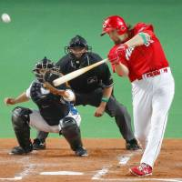 The Carp's Brad Eldred slugs a two-run homer in the second inning on Tuesday night. | KYODO
