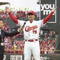 Carp manager Koichi Ogata is interviewed after Saturday's series-clinching victory over the BayStars. | KYODO