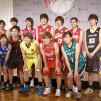 Players from the 12 WJBL teams pose for a photo at a news conference at a Tokyo hotel on Monday. | KAZ NAGATSUKA