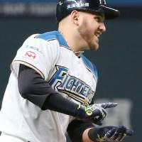 The Fighters' Brandon Laird demonstrates the sushi pose earlier this season. | KYODO