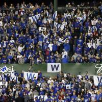 Chicago Cubs fans are rooting for the team to advance to the World Series and capture its first title since 1908. | AP