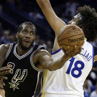 Spurs crush Warriors to pour cold water on Durant's debut