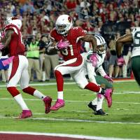 Johnson, Cardinals roll past struggling Jets