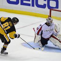 Pens prevail in shootout opener over Caps