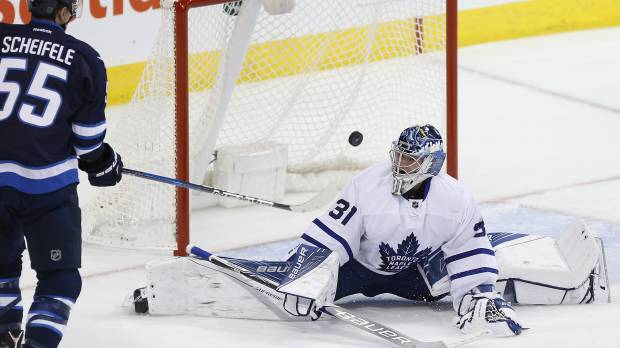 Jets rally from four down, beat Leafs in OT