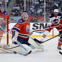 Oilers beat Jets in Heritage Classic