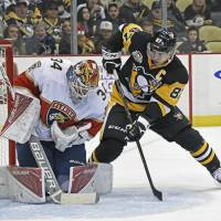 Crosby returns to power Penguins