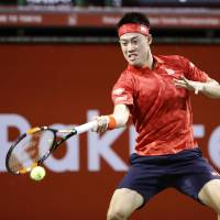Nishikori overcomes shaky start to beat Young at Japan Open