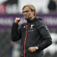 Liverpool manager Jürgen Klopp's team faces a marquee match against Manchester United on Monday. | REUTERS