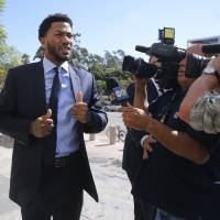 Rose's accuser gives tearful testimony
