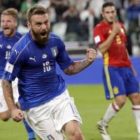 Italy manages draw against Spain