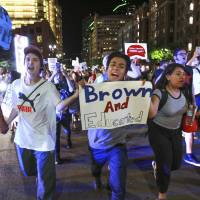Abraham Barragan, 18, center, and around 300 other people protest president-elect Donald Trump as they march down Broadway in downtown San Diego on Nov. 9. | HAYNE PALMOUR IV / SAN DIEGO UNION-TRIBUNE