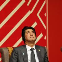 Japanese Prime Minister Shinzo Abe attends a meeting of the APEC Business Advisory Council in Lima on Saturday. | REUTERS
