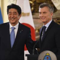 Prime Minister Shinzo Abe poses with Argentine President Mauricio Macri during a news conference in Buenos Aires on Monday. | AFP-JIJI