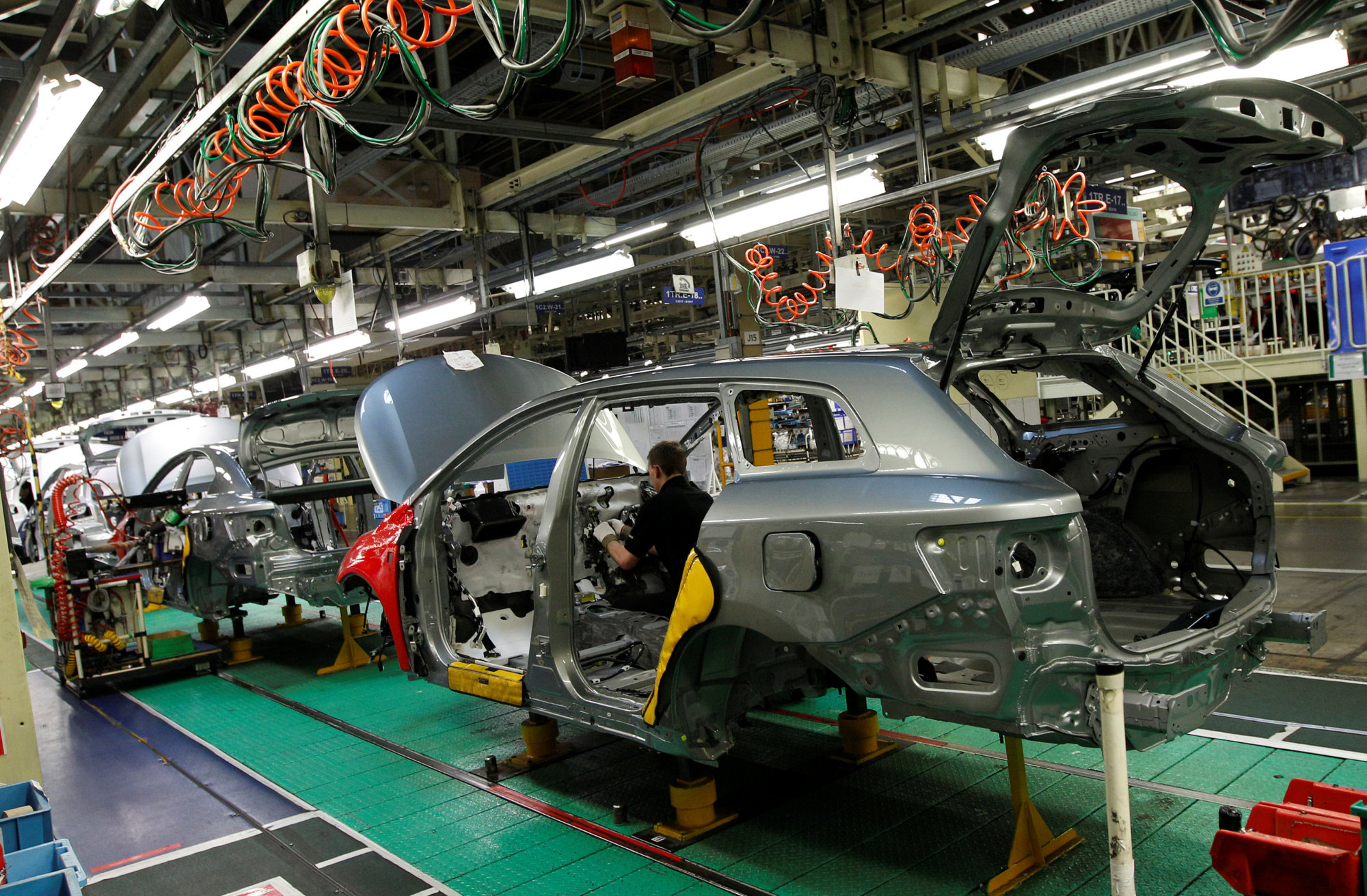 A man works on the production line at the Toyota factory in Derby, England, in March 2011. | REUTERS