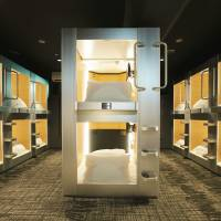 New Japan Kanko Co.'s Cabana hotel in the city of Osaka is among a new breed of capsule hotels that are reaching out for a broader range of guests. | NEW JAPAN KANKO CO. / VIA KYODO