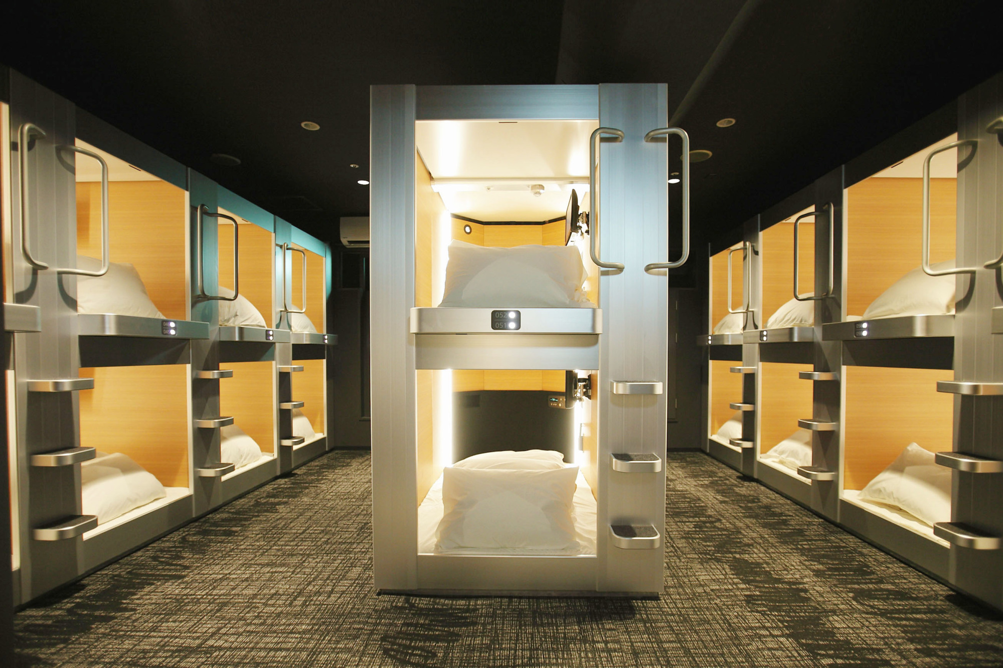Once Aimed At Salarymen, Japan's New Capsule Hotels Reach