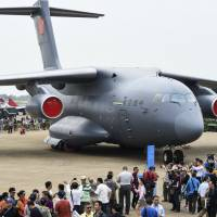 A Chinese Y-20 heavy strategic transport aircraft is displayed at China's International Aviation and Aerospace Exhibition in Zhuhai, China, on Tuesday. | AP