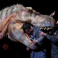 Robotic dinosaur replicas stomp on stage in Tokyo ahead of planned park