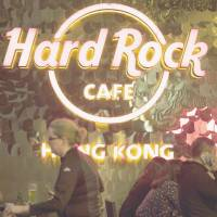 An sign is displayed on a terrace at the Hard Rock Cafe Hong Kong in February. Operator Hard Rock Cafe International Inc. is reportedly preparing to make a major investment in Japan, which is debating legalization of casinos. | BLOOMBERG