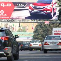 Iranian police have stopped issuing number plates for U.S.-made cars, including Japanese brands such as this Toyota seen in Tehran on Saturday. | KYODO