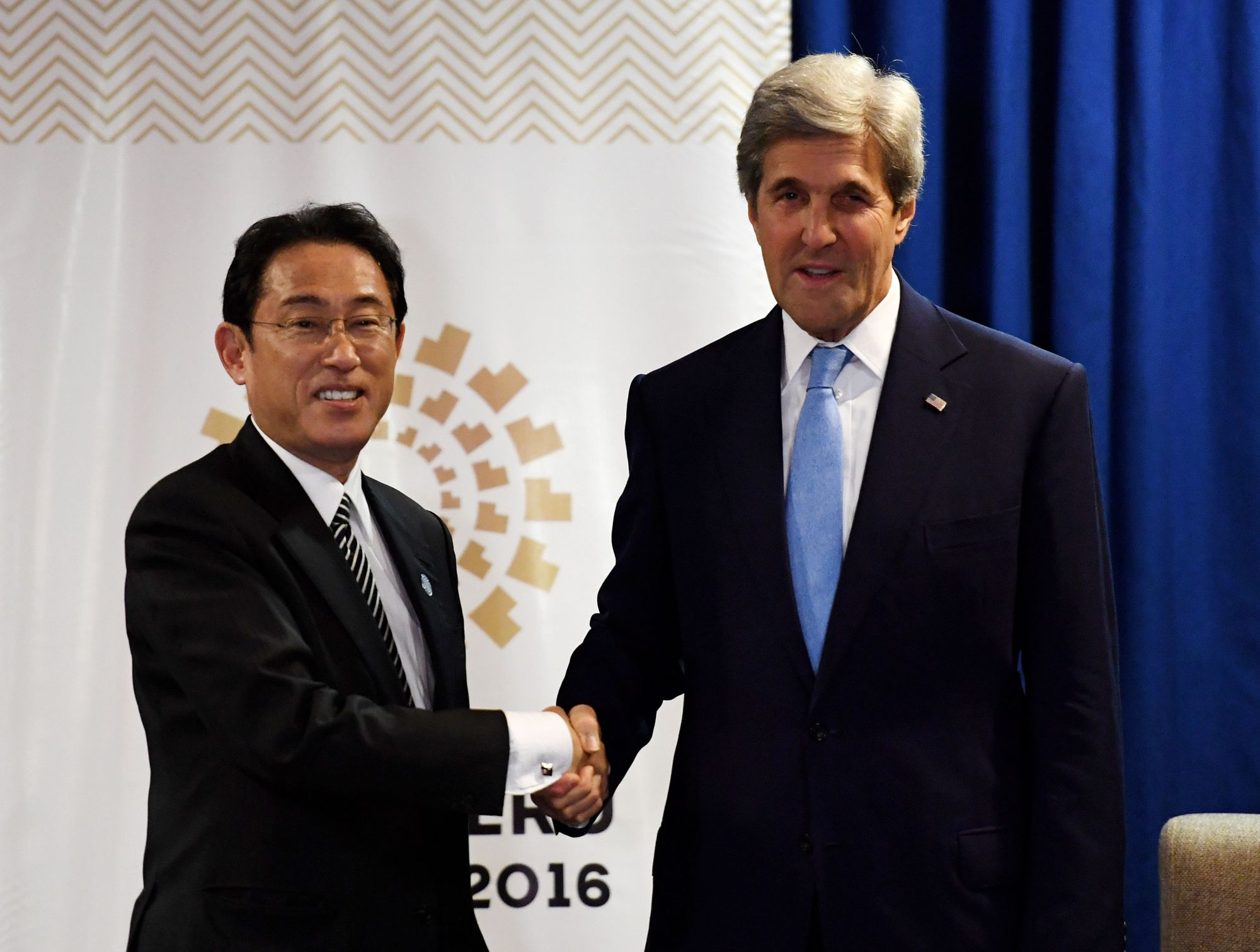 U.S. Secretary of State John Kerry meets with Foreign Minister Fumio Kishida during a bilateral meeting at the APEC Ministers Meetings in Lima on Thursday. | AFP-JIJI