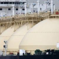 A liquefied natural gas tanker is berthed at Tokyo Electric Power Company Holdings Inc.'s Futtsu gas-fired thermal power plant in Futtsu, Chiba Prefecture. | BLOOMBERG