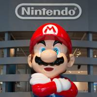A statue of Nintendo Co.'s video-game character Mario is seen at the Nintendo Game Front showroom in Tokyo. | BLOOMBERG
