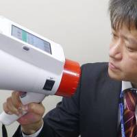 Panasonic Corp.'s new megaphone features automatic translation of Japanese into English, Chinese and Korean.   KYODO