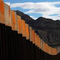 A general view shows a newly built section of the U.S.-Mexico border wall from the Mexican side at Sunland Park, Texas, opposite the Mexican border city of Ciudad Juarez Wednesday. | REUTERS
