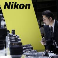 Nikon Corp. is reportedly considering slashing some 1,000 domestic jobs as part of efforts to restructure its chip and camera business. | BLOOMBERG