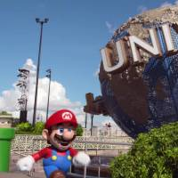 A screen shot of a YouTube video shows Mario, Nintendo's popular game character, walking in the Universal Studios theme park after popping out of a pipe.