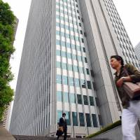 The Shinjuku Nomura Building in Tokyo has recently been fitted with a vibration control system to help it survive earthquakes. | BLOOMBERG